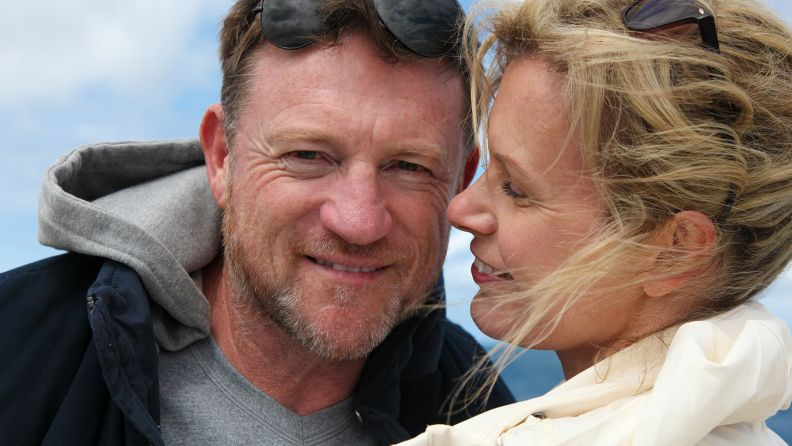 Close up of mature couple hugging and smiling at Bondi Beach