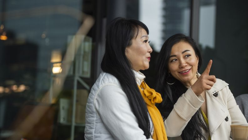 Two asian women talking